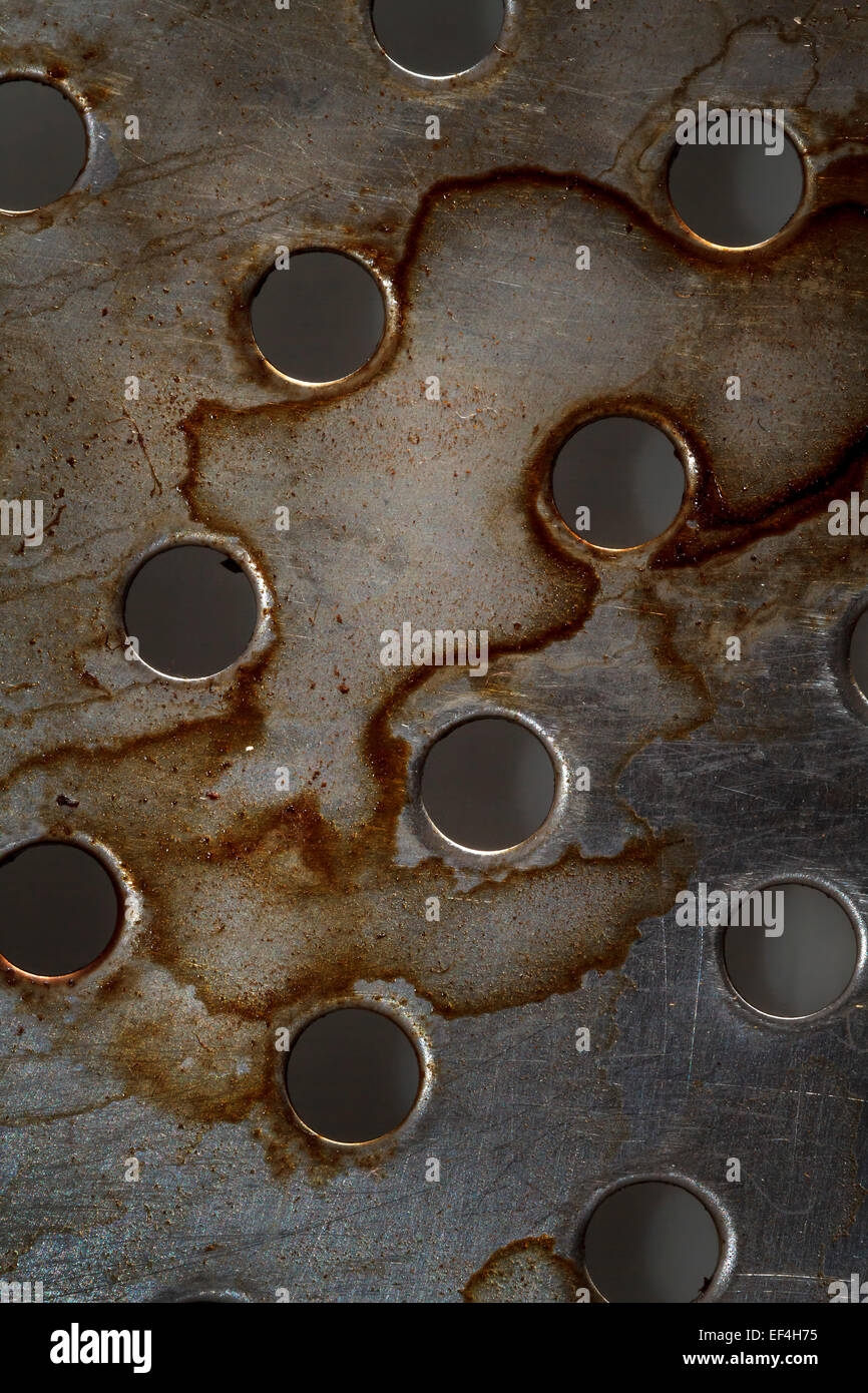 metal texture with holes, abstract background - Stock Image