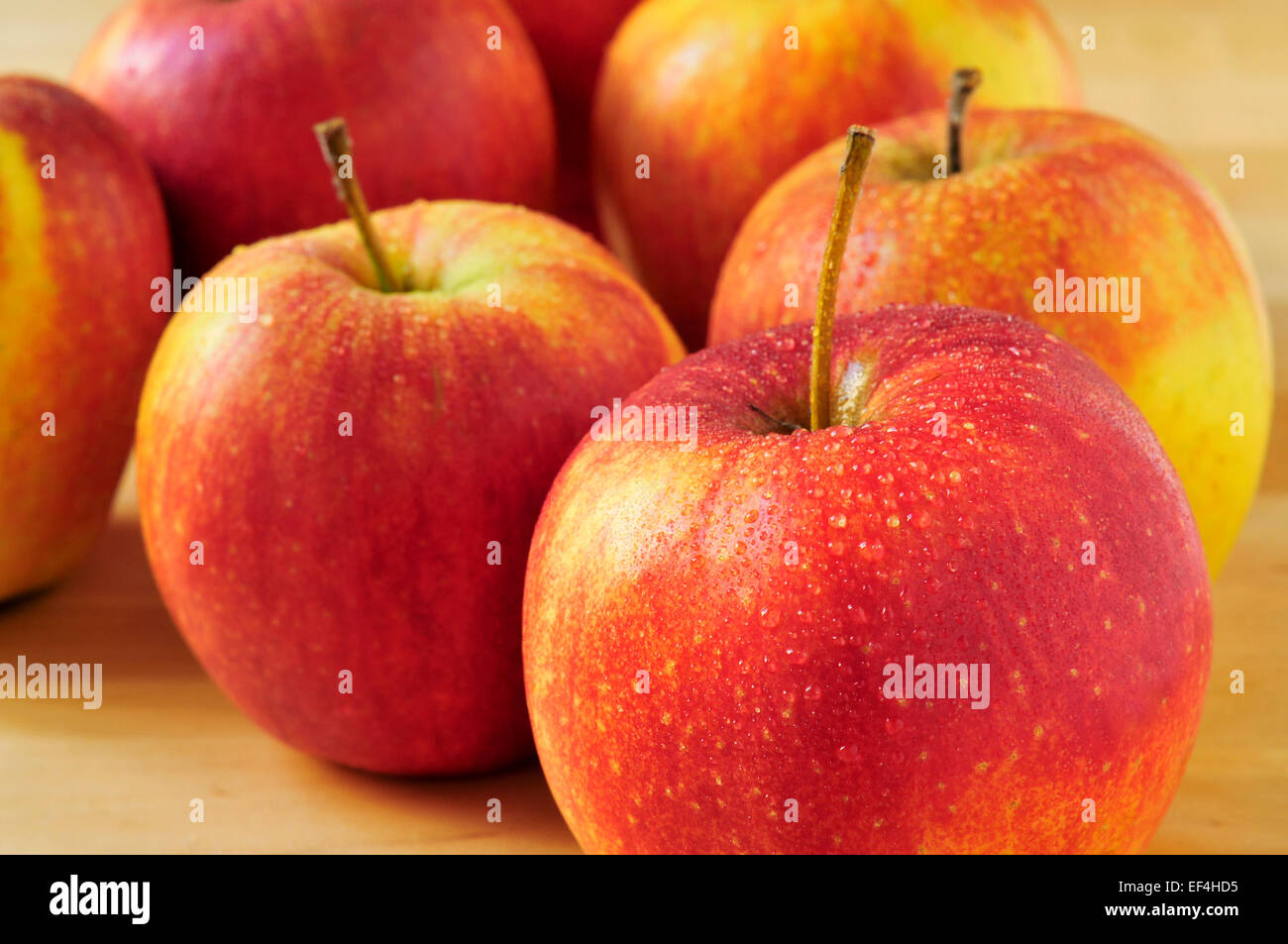 closeup of a pile of appetizing and fresh apples on a table - Stock Image