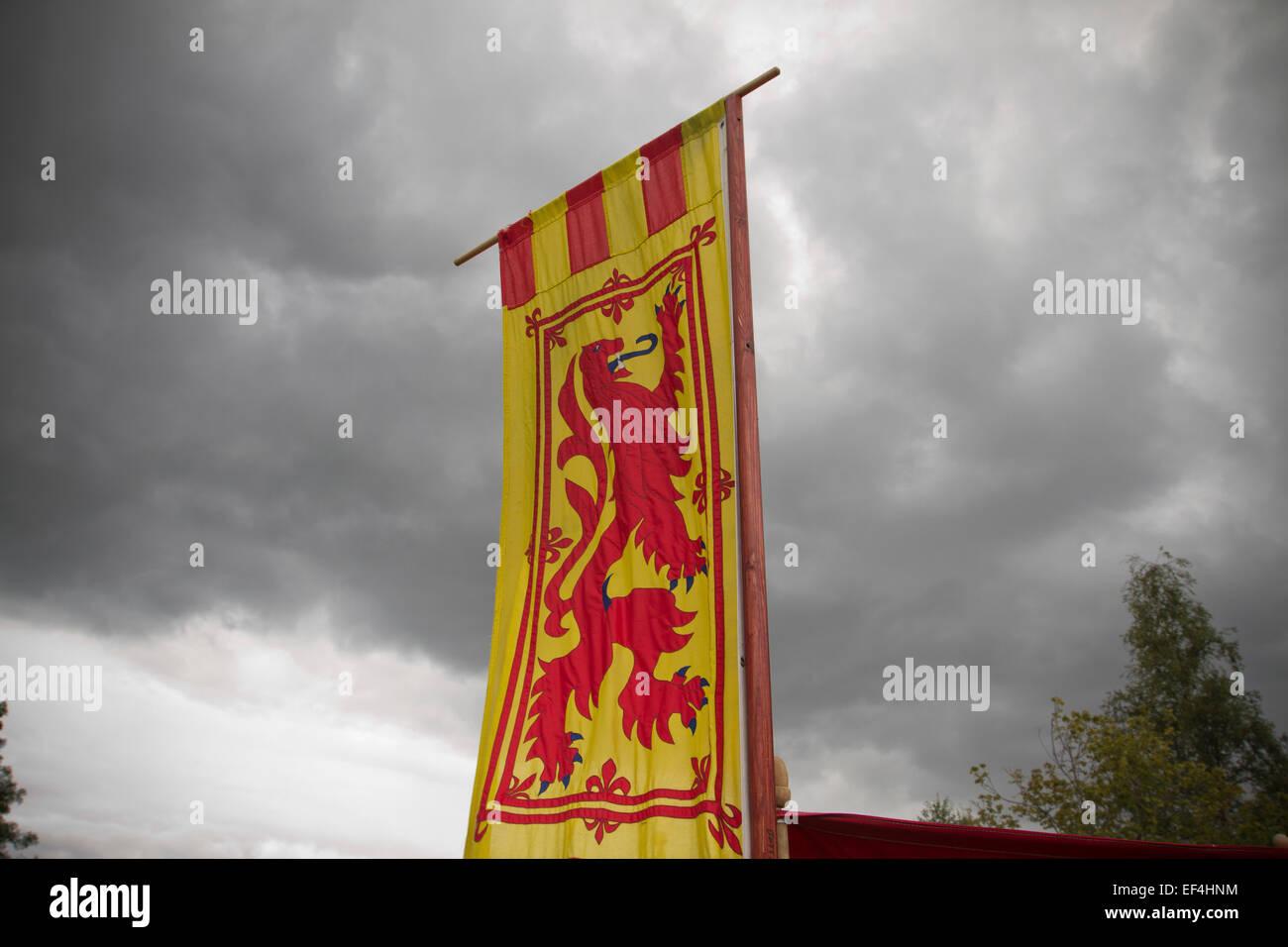 A Scottish lion rampant banner pictured during events at Bannockburn Live, at Bannockburn, Stirlingshire. - Stock Image