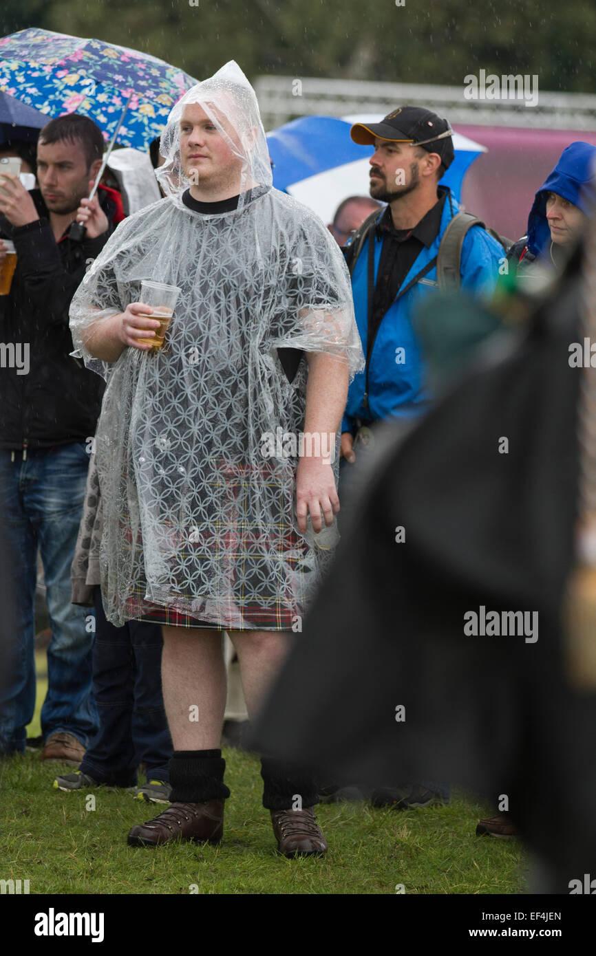 Two men dressed in kilts and rain ponchos during events at Bannockburn Live, at Bannockburn, Stirlingshire. Stock Photo