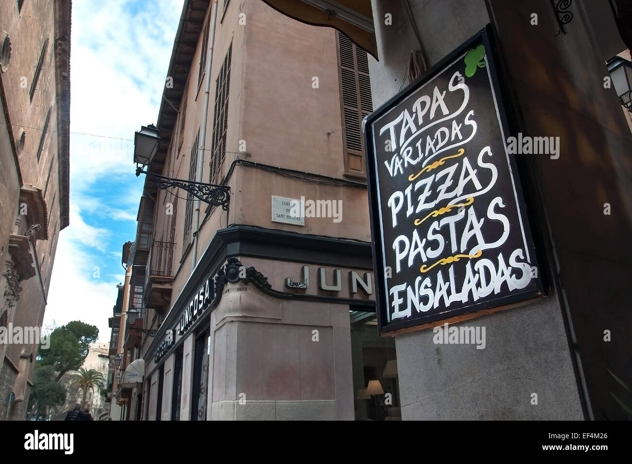 PALMA DE MALLORCA, SPAIN - FEBRUARY 8, 2013: City view and an advertising text on chalkboard in a tapas bar. - Stock Image