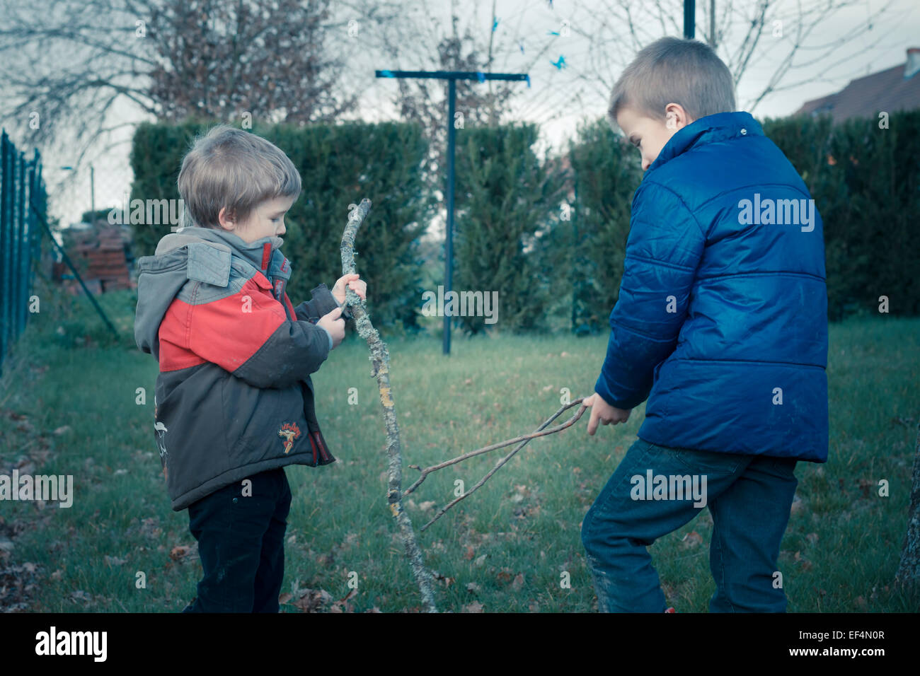 children brothers playing outdoors france - Stock Image