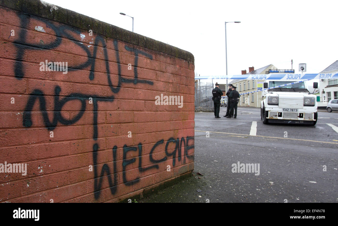 Police officers close off a road leading to Old Park police station, following an explosion to the perimeter wall - Stock Image