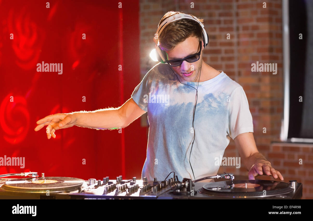 Cool dj spinning the decks - Stock Image
