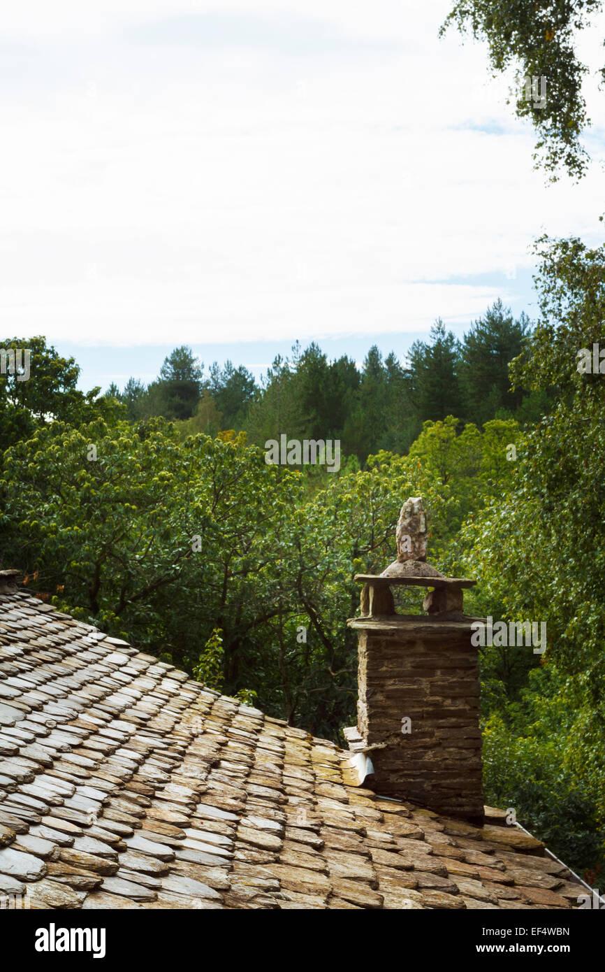 schsit roof, chimney, cévennes france - Stock Image