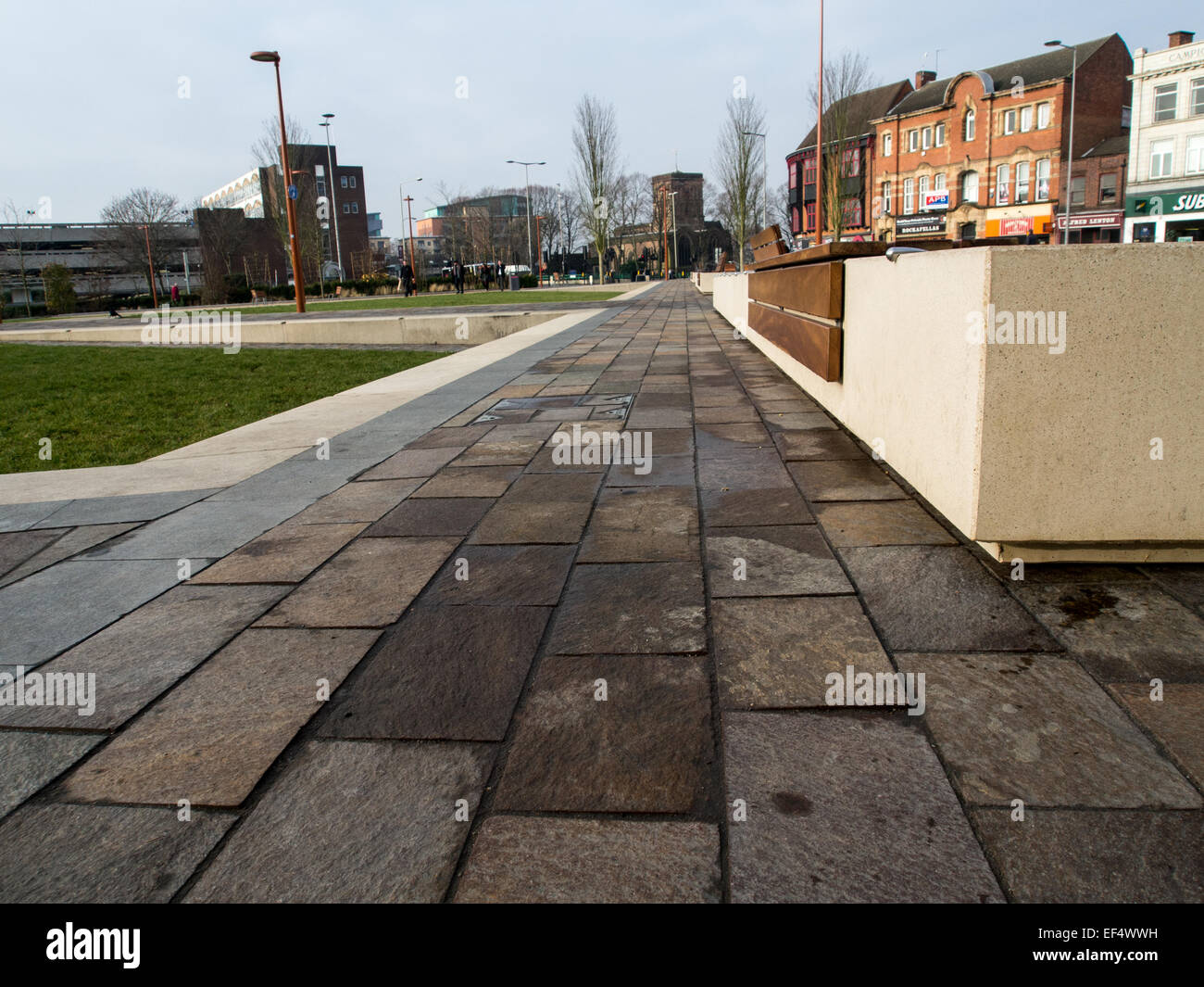 Street Furniture: Wood seating fixed onto concrete plinths in Jubilee Square, Highcross, Leicester. - Stock Image