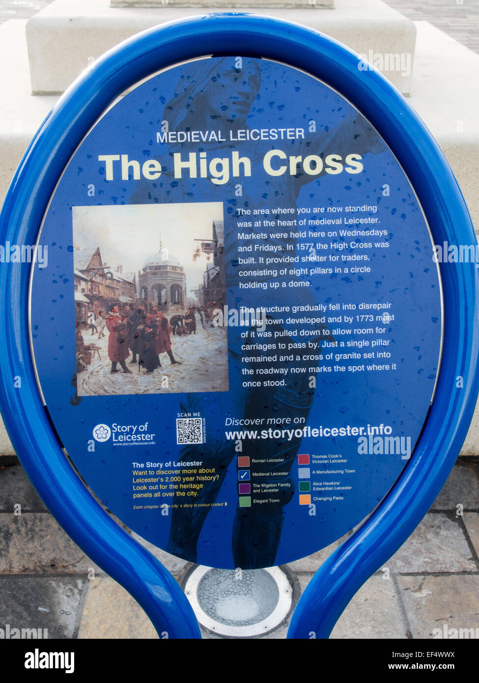 Street Furniture; Blue metal Information sign to explain and culture and history of medieval The High Cross. - Stock Image