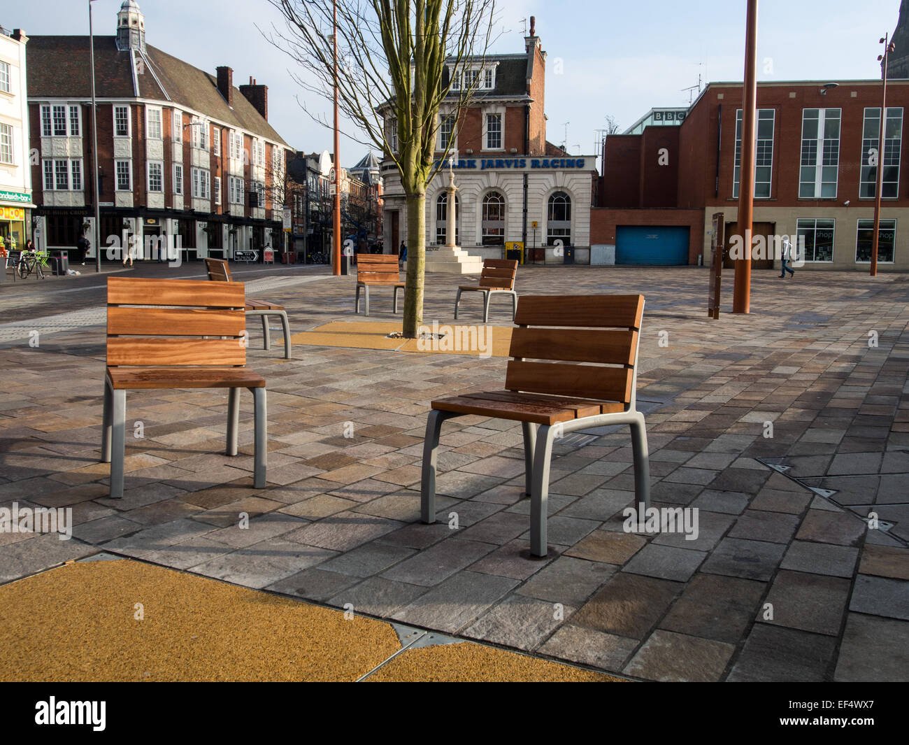 Street Furniture: Wood on metal seating fixed into the granite pavement area of the Jubilee Square, Highcross, Leicester. - Stock Image