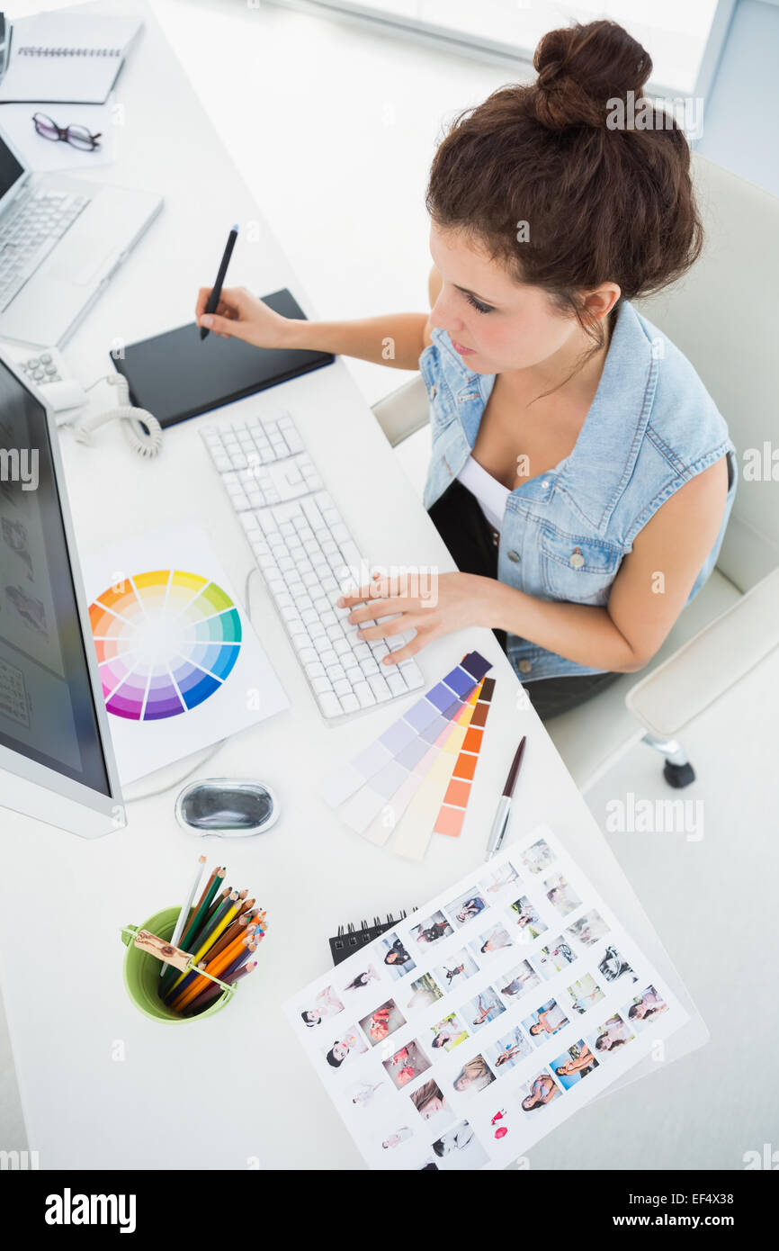 Designer working with colour wheel and digitizer - Stock Image