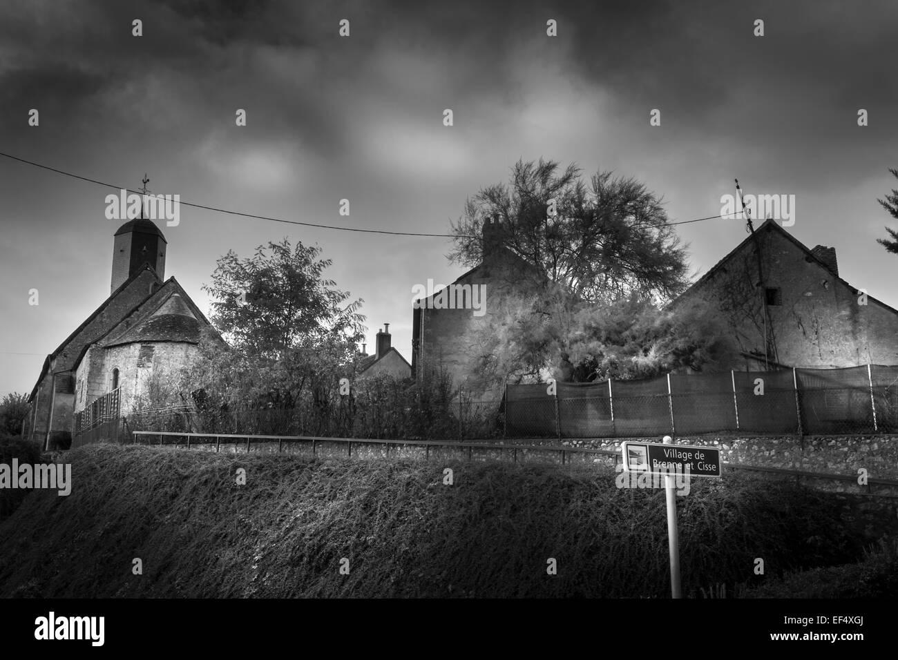 Buildings sitting on a hill, neuille-le-lierre village, Indre-et-Loire, France. - Stock Image