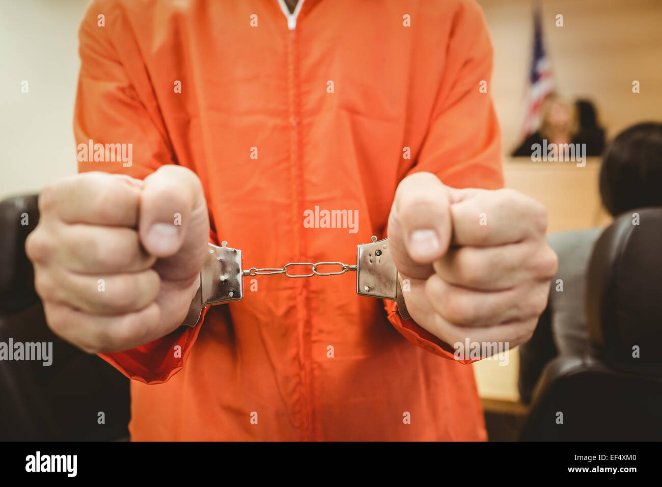 Prisoner in handcuffs clenching fists - Stock Image