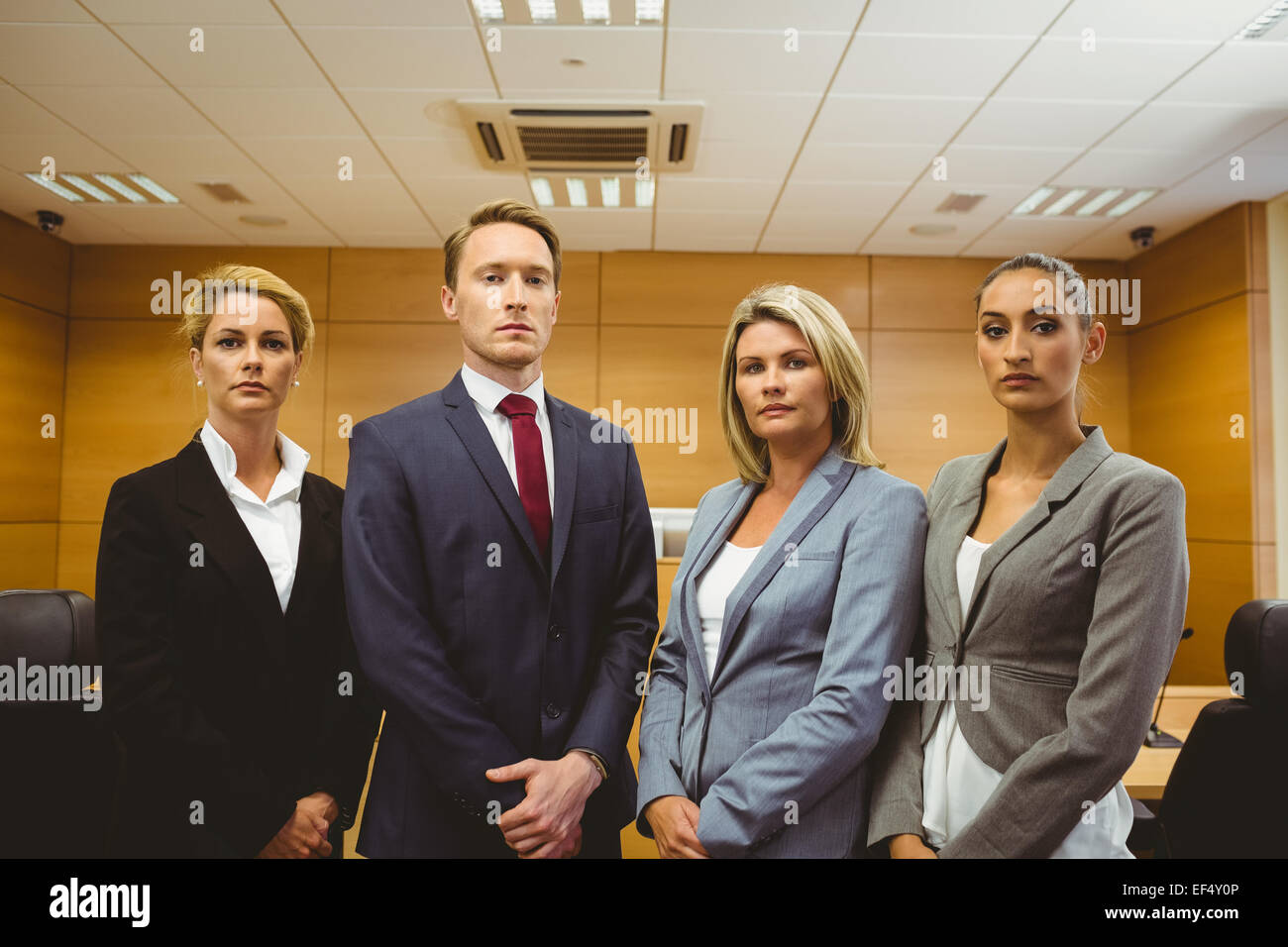 Portrait of four well-dressed lawyer - Stock Image