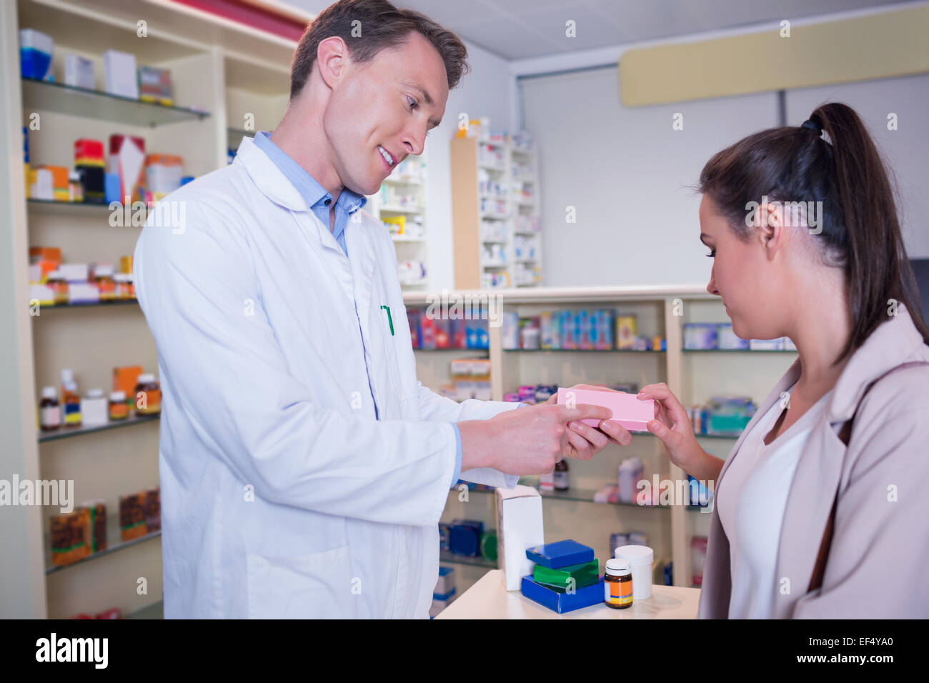 Pharmacist and customer discussing a product Stock Photo