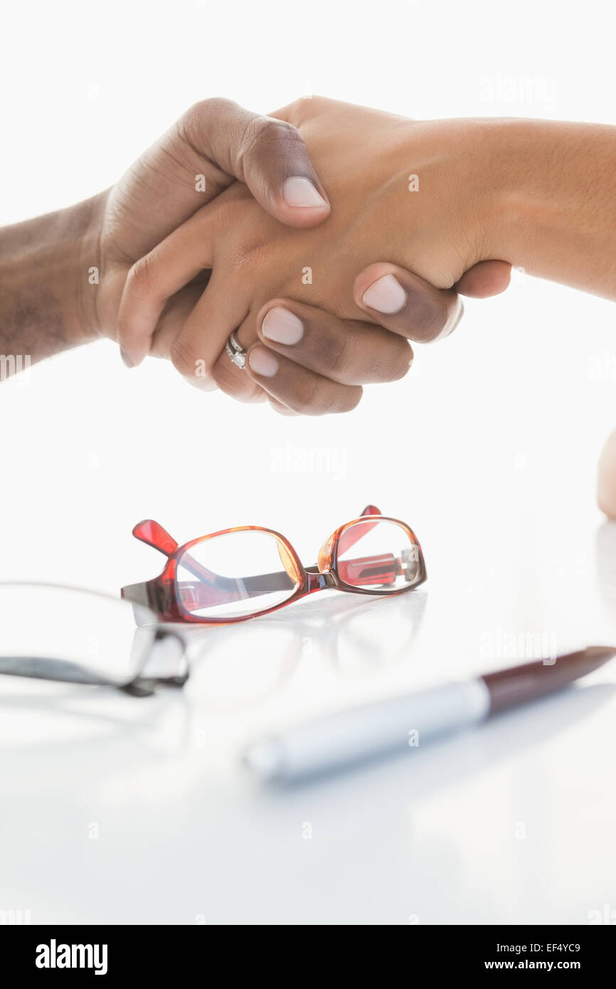 Handshake to seal a deal after a business meeting - Stock Image