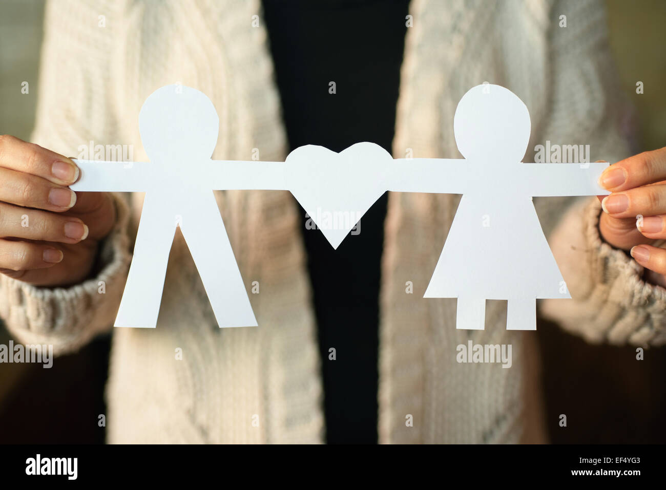 Two paper men with heart shape - Stock Image