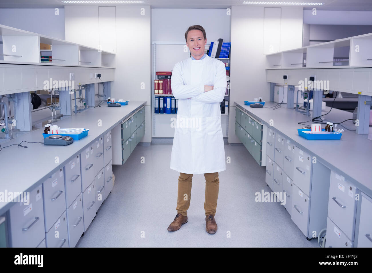 Portrait of a smiling biochemist standing with arms crossed Stock Photo