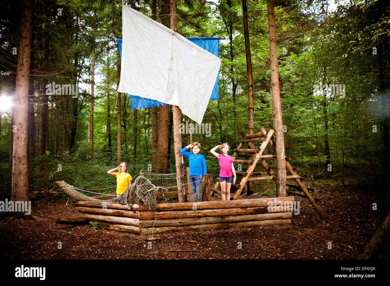 Children playing on wooden sailboat, Munich, Bavaria, Germany - Stock Image