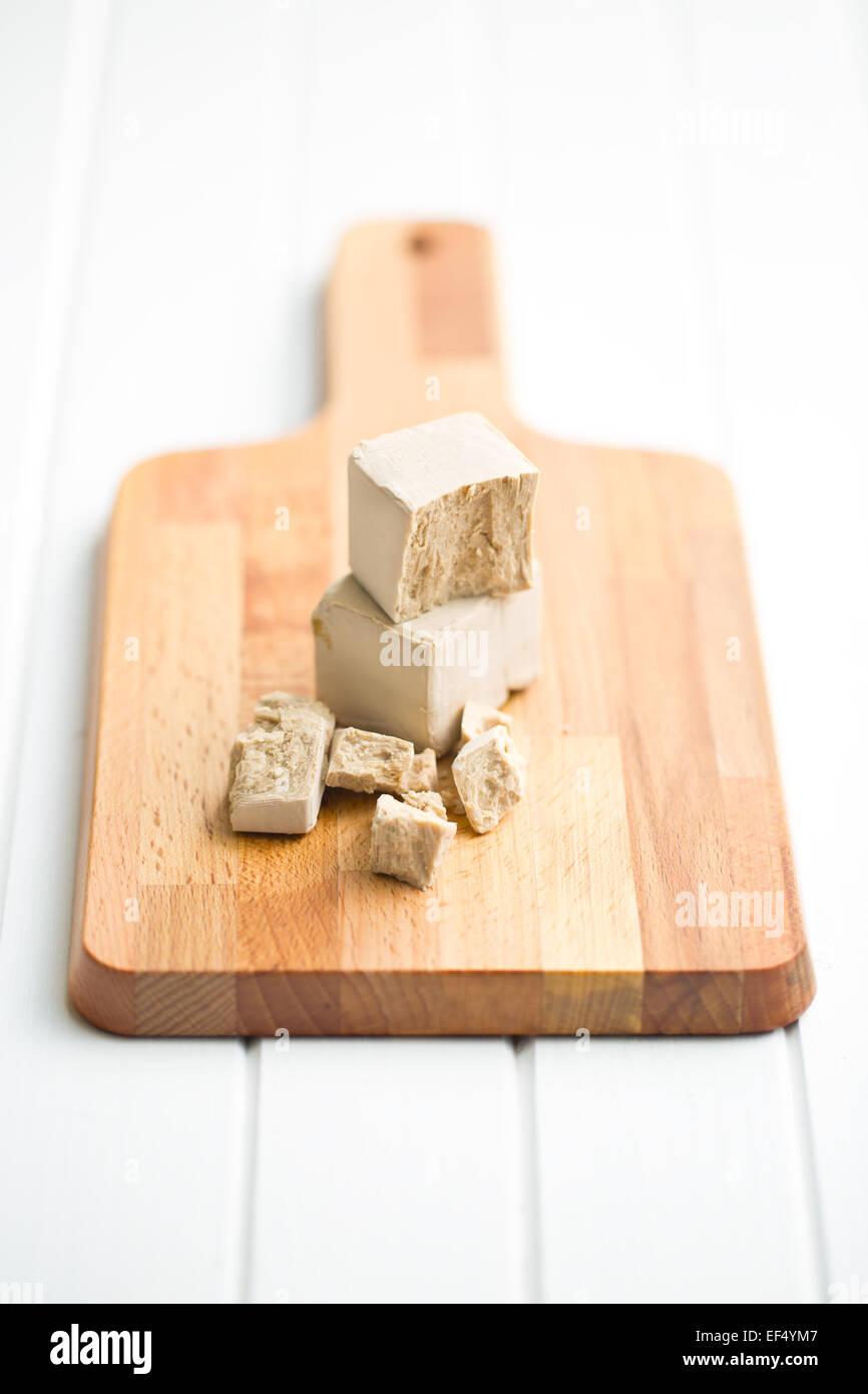 fresh yeast on cutting board - Stock Image