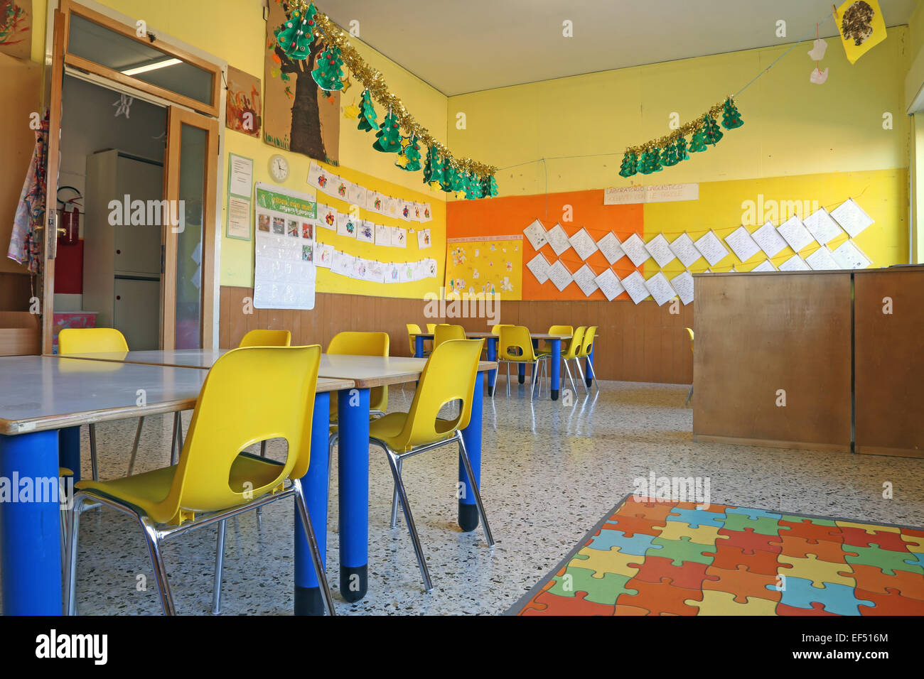 preschool classroom with yellow chairs and table stock image - Kinder Garden