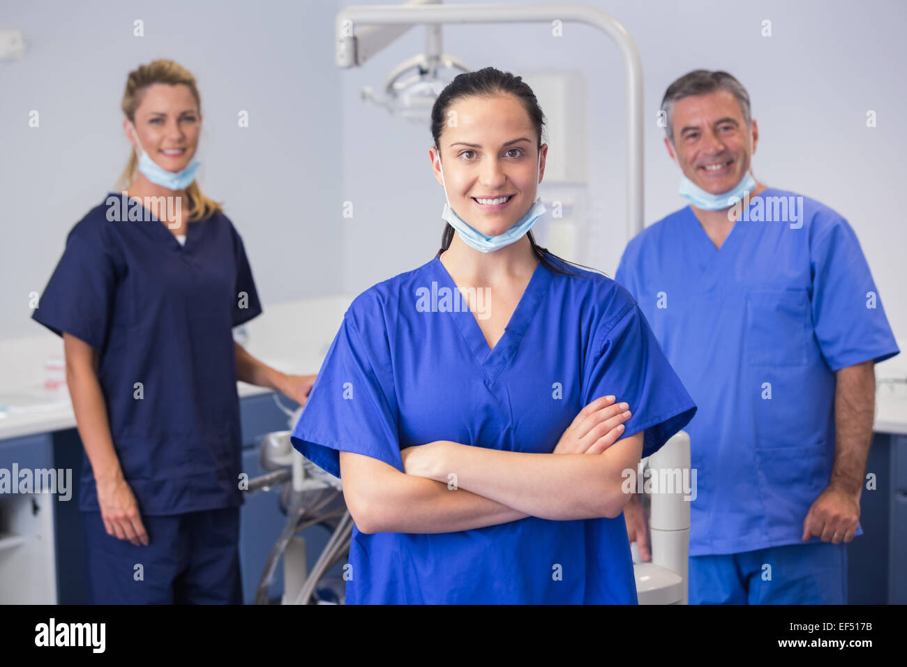 Portrait of smiling co-workers standing - Stock Image
