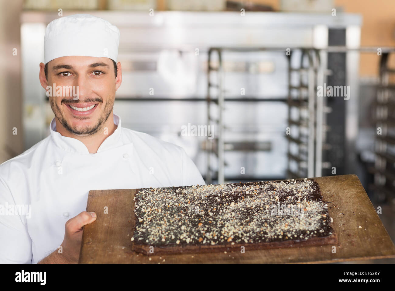 Baker showing freshly baked brownie Stock Photo