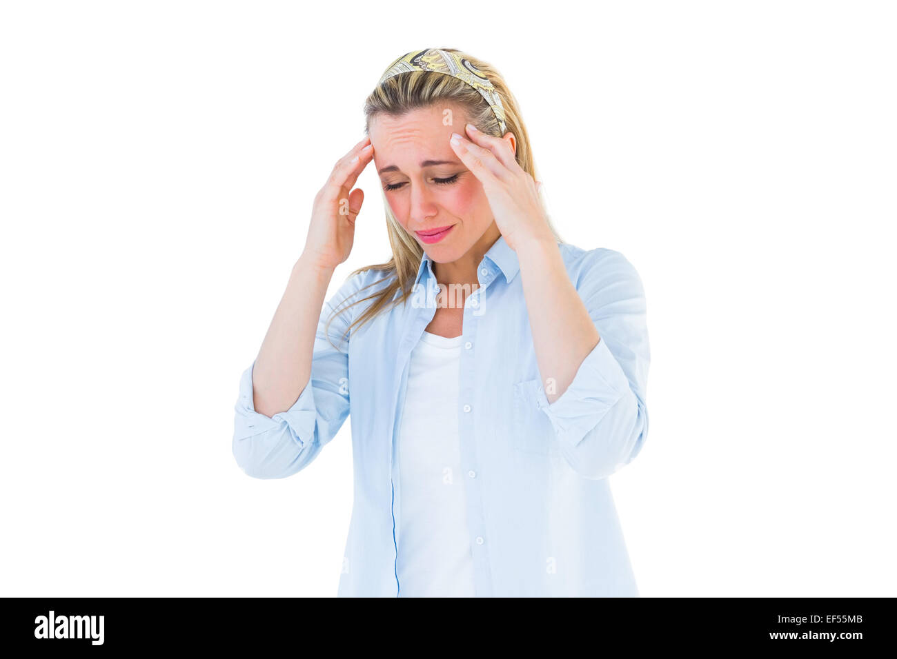 Pretty blonde grimacing and getting a headache - Stock Image