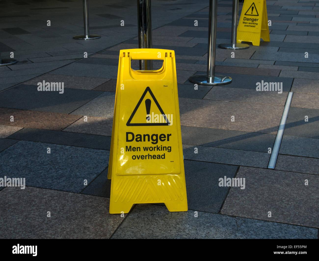 Men Working Sign Yellow Street Furniture - Stock Image