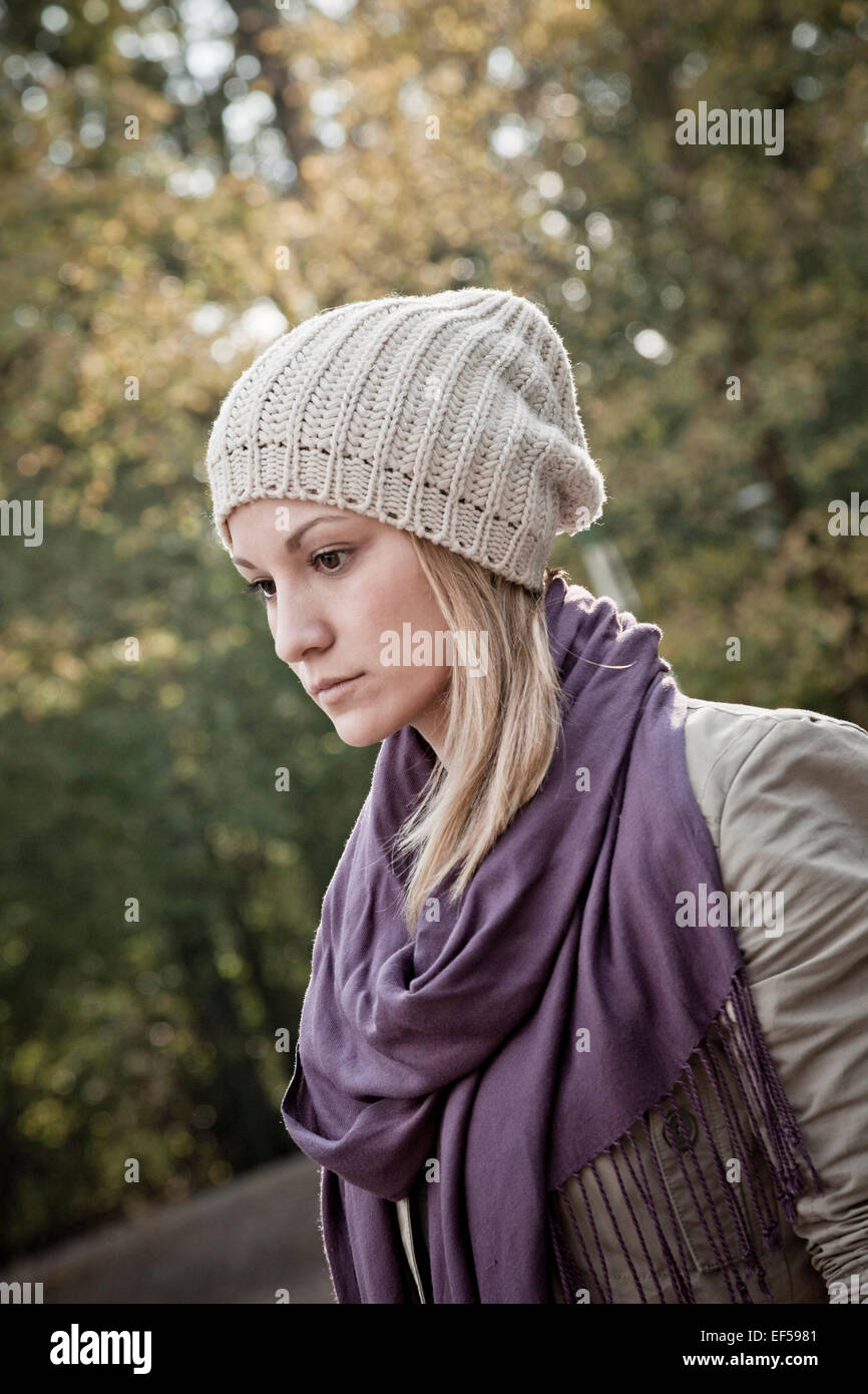 Portrait of young woman with knit hat - Stock Image
