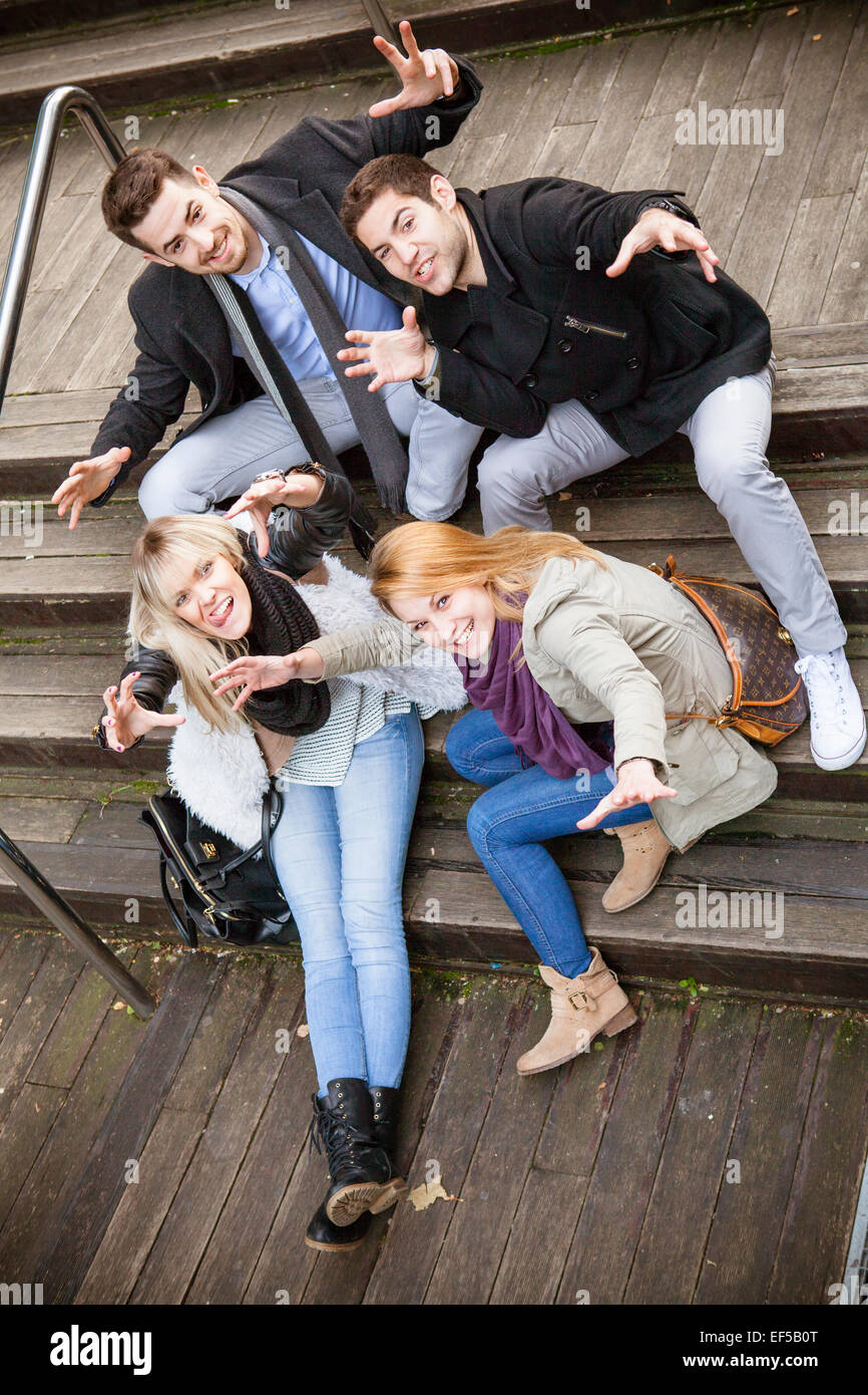 Group of friends having fun in town - Stock Image