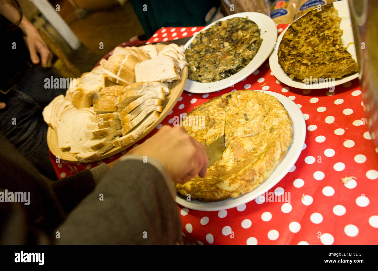 Passing Clouds in Dalston launches a new free cooking and dinner event on Sunday. The idea is people bring some - Stock Image