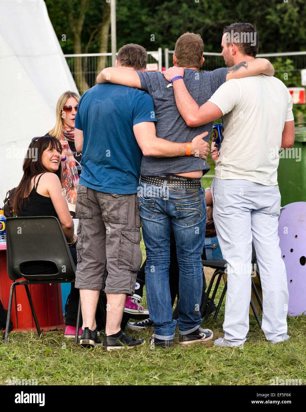 A group of men friends at Sheep Music festival near Presteigne, Powys - Stock Image