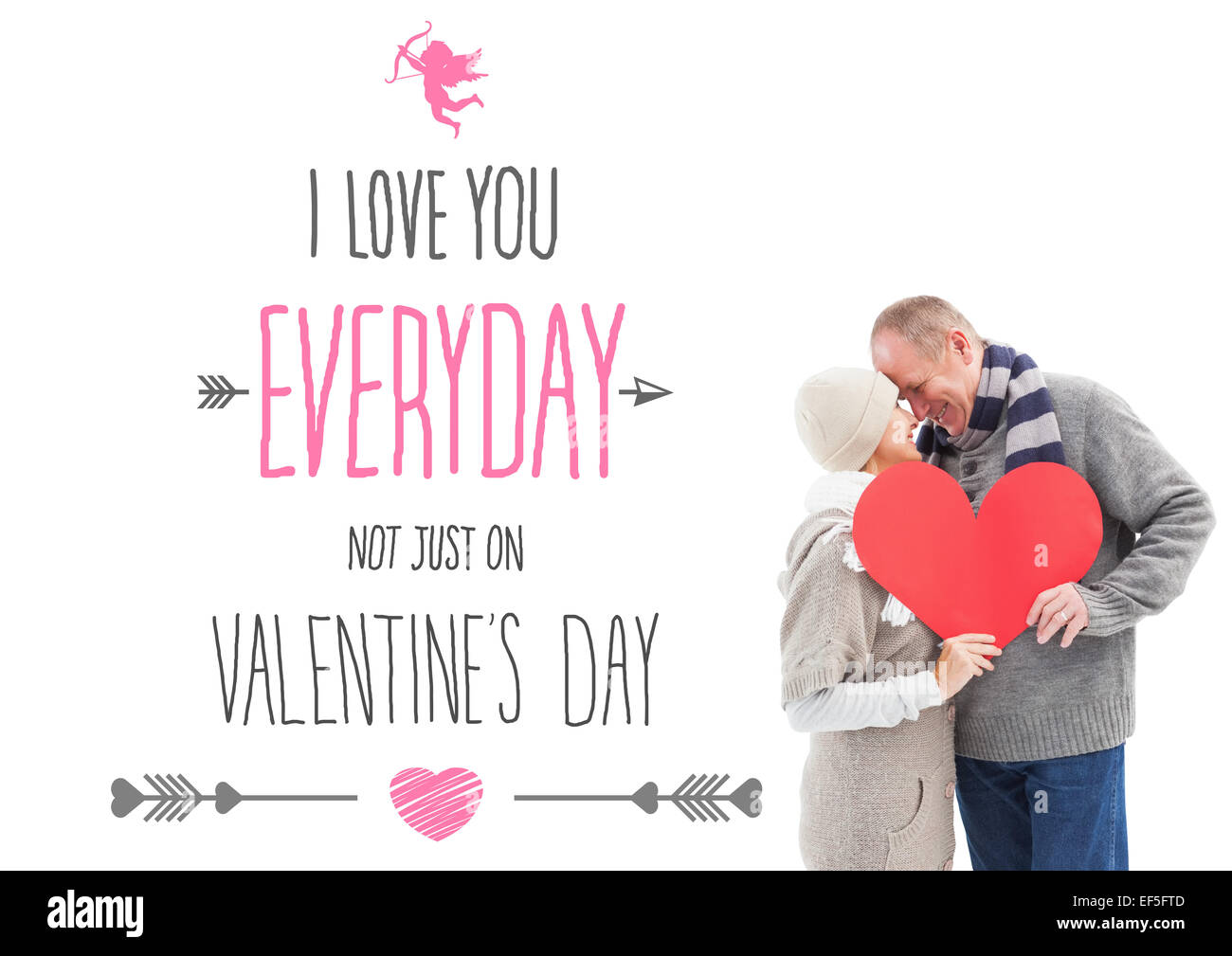 Composite image of happy mature couple in winter clothes holding red heart - Stock Image