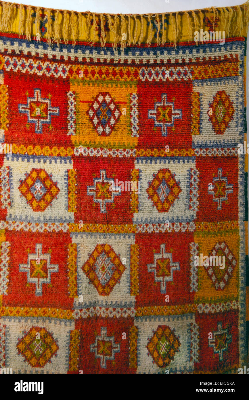 Traditional antique hand woven Moroccan rug - Stock Image