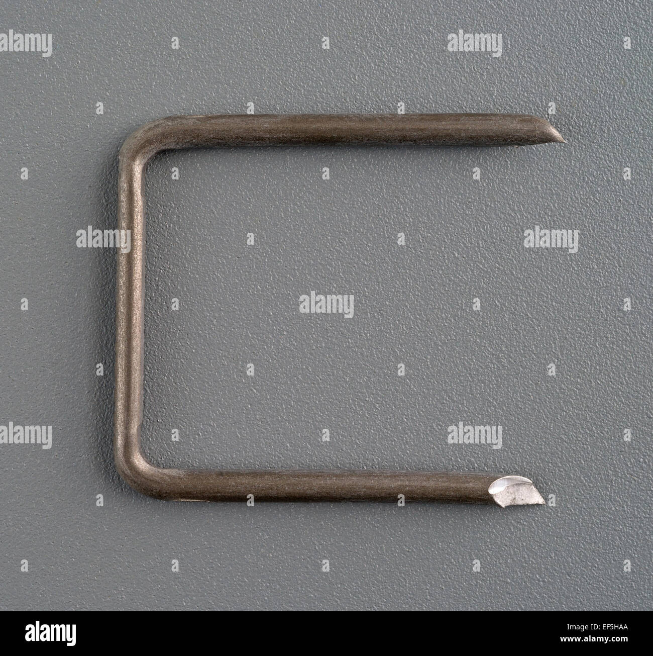 a large electrical cable tack for heavy gauge wiring on a gray background