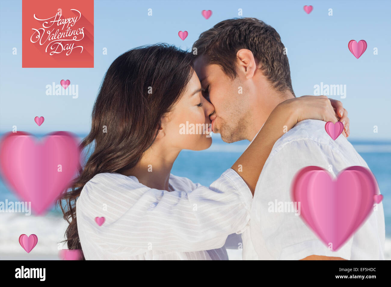 Composite image of couple embracing and kissing each other on the beach Stock Photo