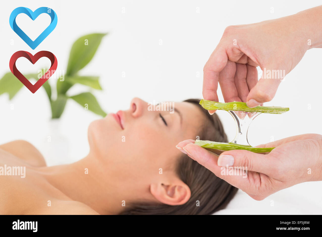 Composite image of attractive young woman receiving aloe vera massage at spa center - Stock Image