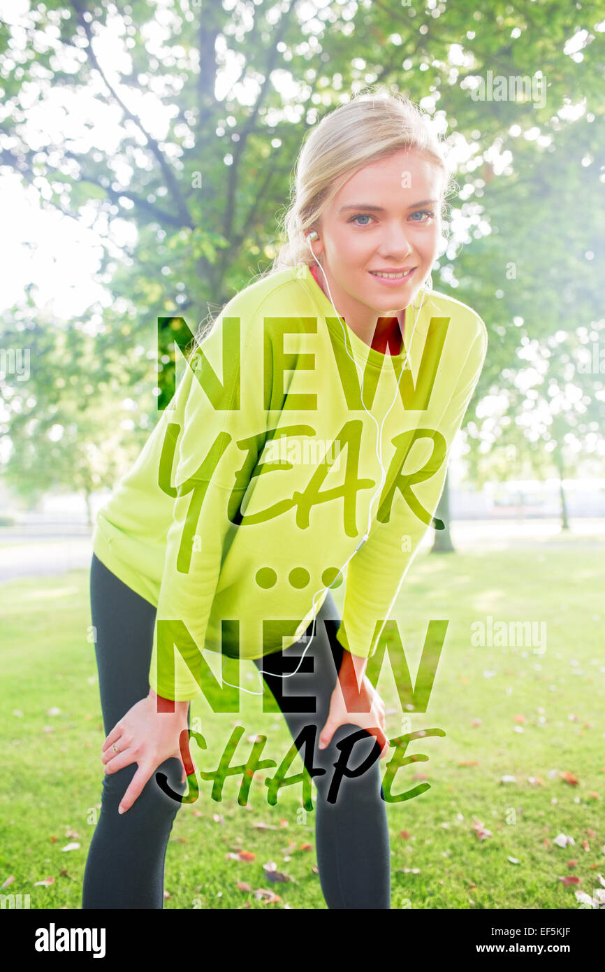 Composite image of active smiling blonde pausing after a run - Stock Image
