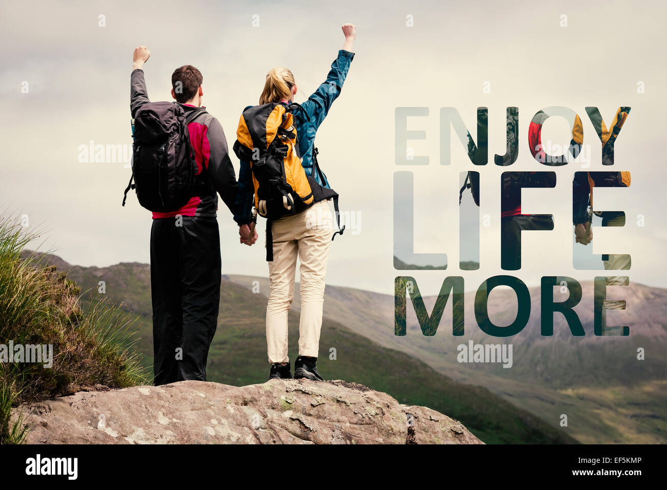 Composite image of excited couple reaching the top of their hike and cheering - Stock Image