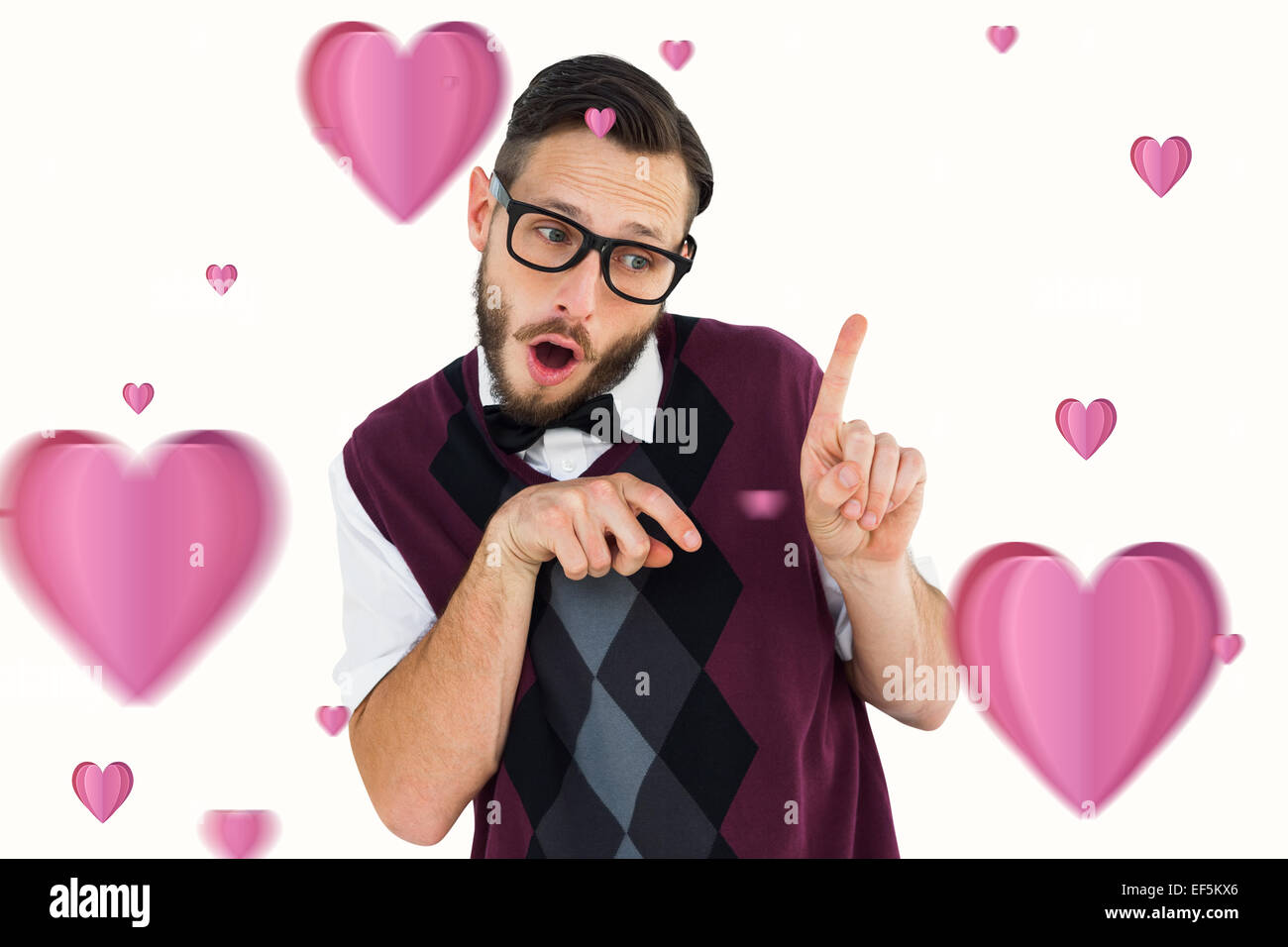 Composite image of geeky hipster in sweater vest pointing - Stock Image