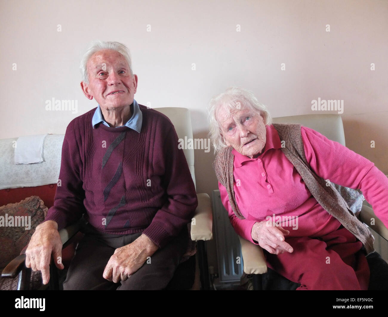 An elderly couple sat at home in their living room in rural Ireland. - Stock Image