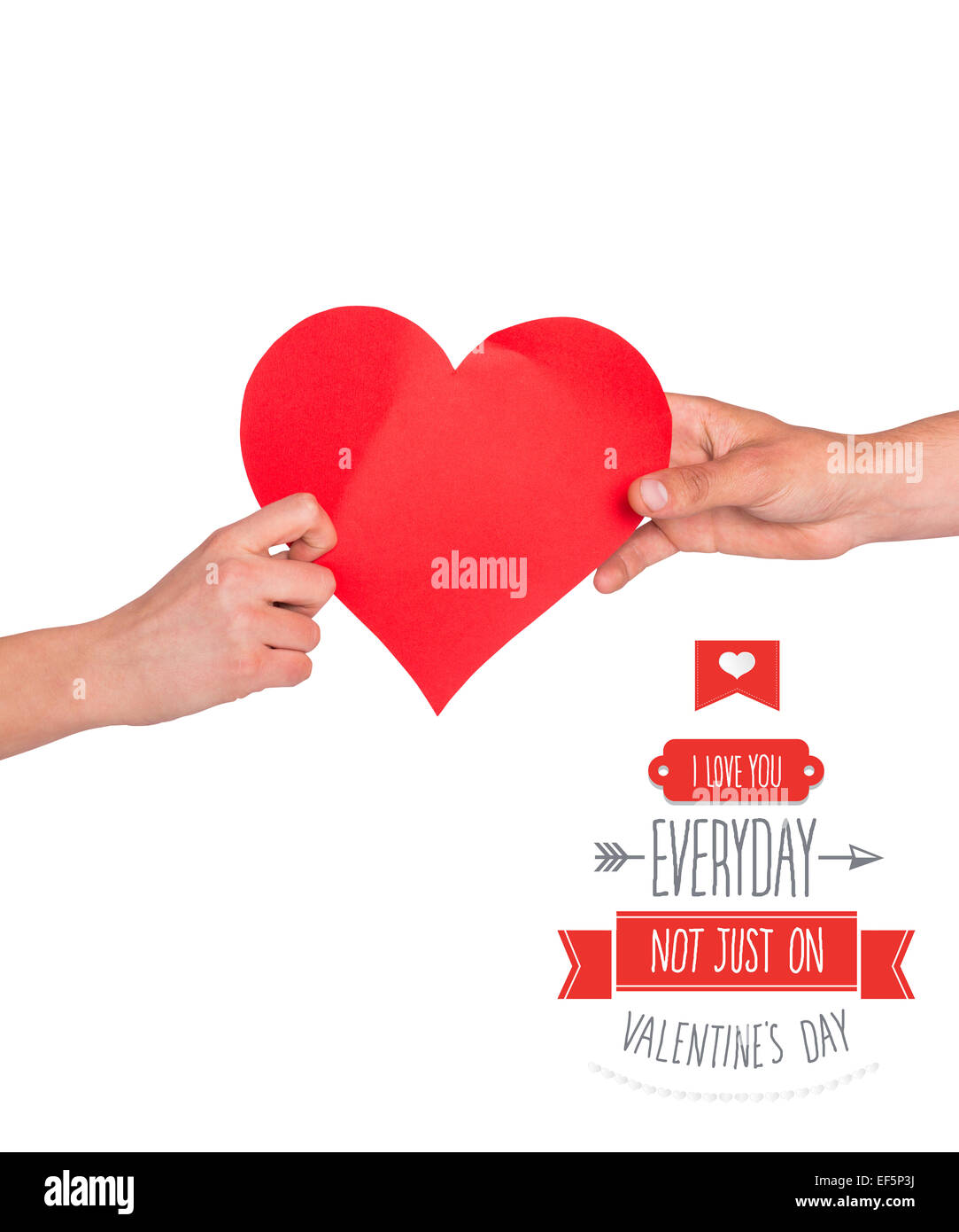 Composite image of hands holding red heart - Stock Image