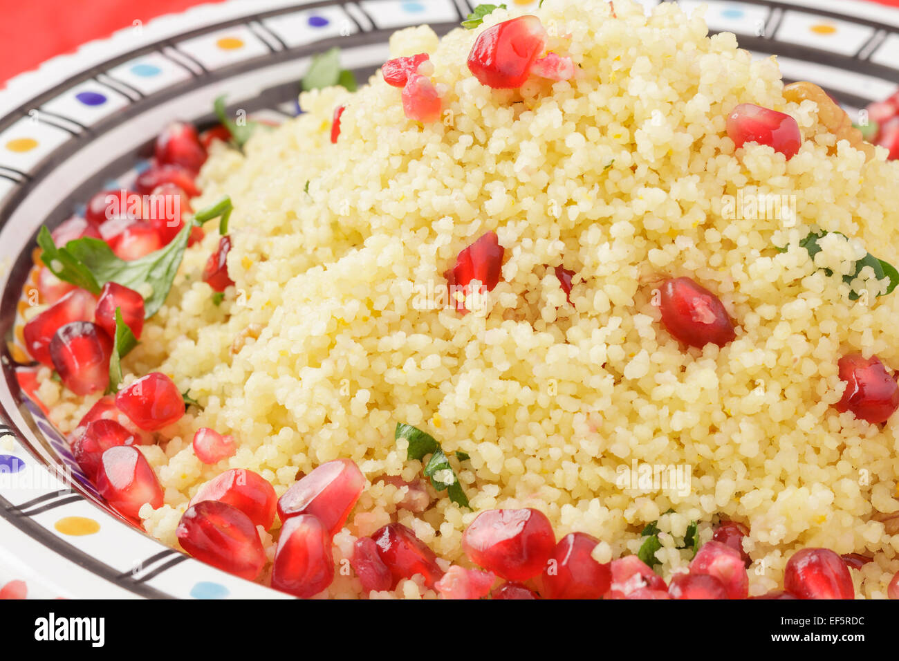 couscous with pomegranate seeds, walnuts and parsley Stock Photo