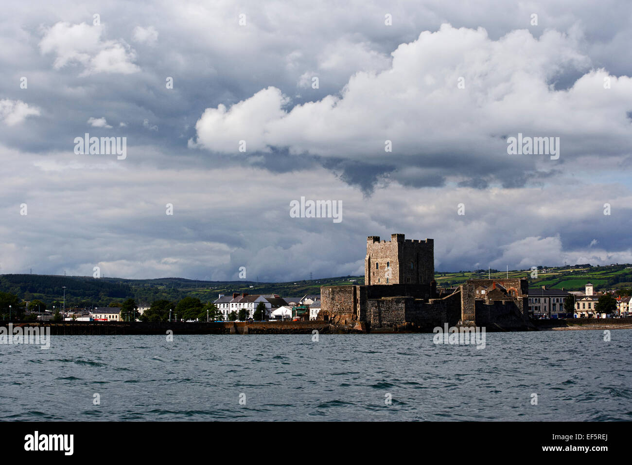 storm clouds over carrickfergus castle and harbour county antrim ireland - Stock Image