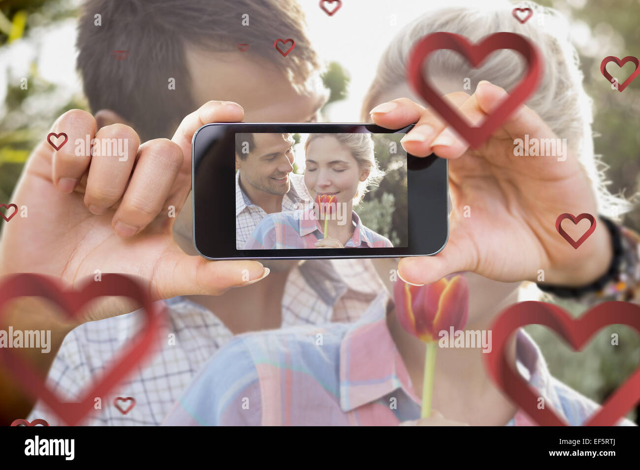 Composite image of valentines couple - Stock Image