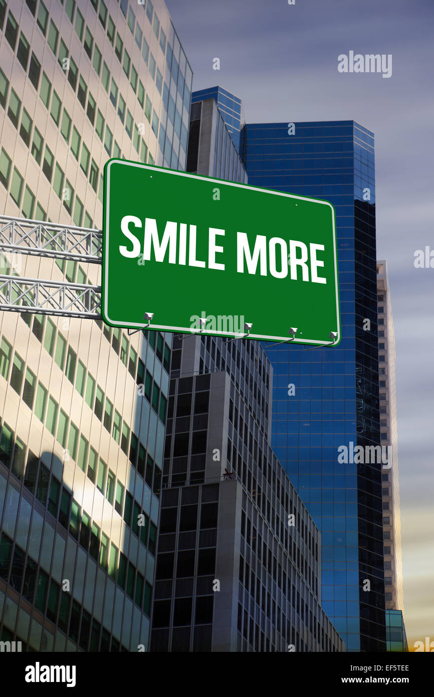 Smile more against low angle view of skyscrapers - Stock Image