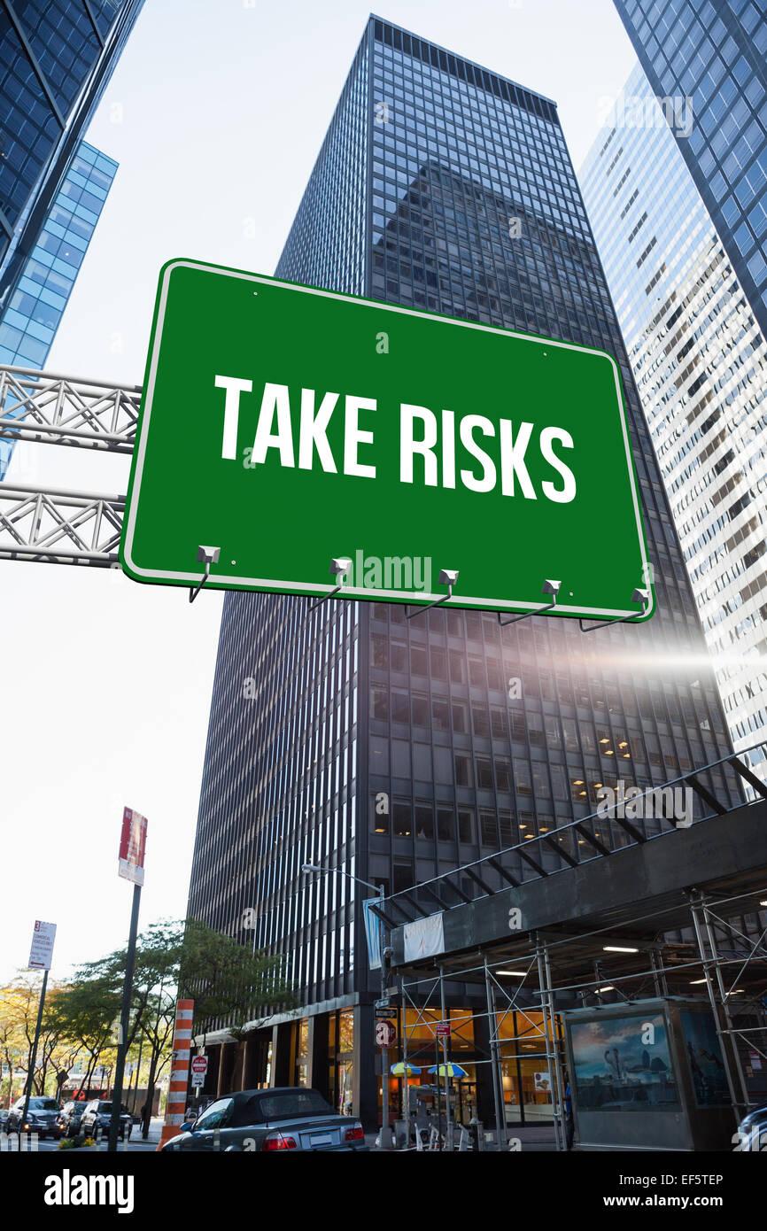 Take risks against skyscraper in city - Stock Image