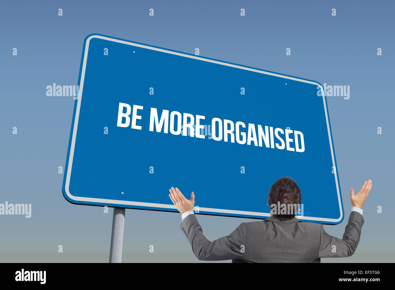 Be more organised against blue sky - Stock Image