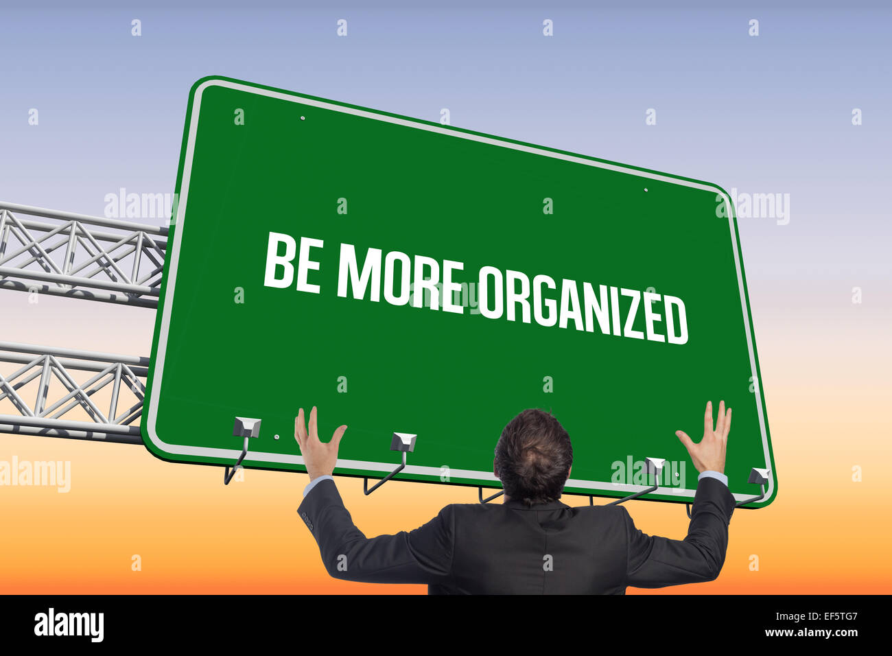 Be more organized against purple and orange sky - Stock Image