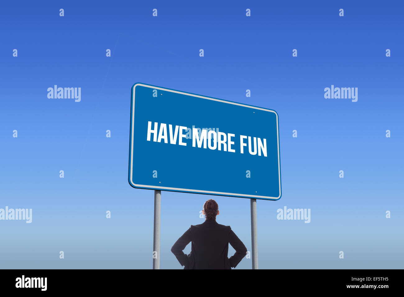 Have more fun against bright blue sky - Stock Image