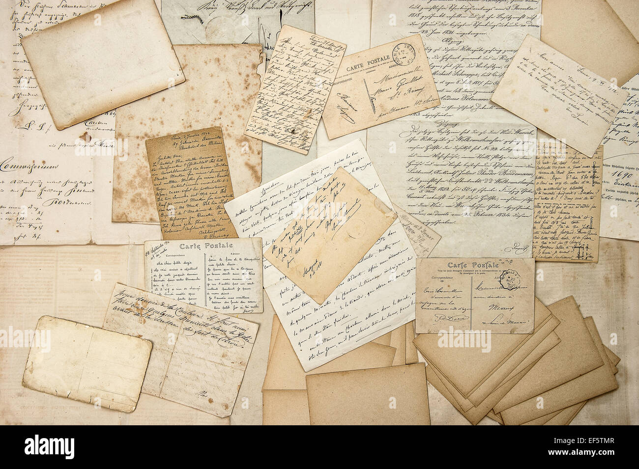 Old letters, handwritings, vintage postcards, ephemera. Grungy paper texture - Stock Image